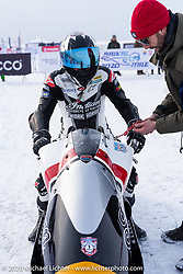 Belgian custom bike builder Brice Hennebert (red hat) with Brices's Appaloosa 2018 Indian Scout Bobber racer and French pilot Sebastien Lorentz at the Baikal Mile Ice Speed Festival. Maksimiha, Siberia, Russia. Thursday, February 27, 2020. Photography ©2020 Michael Lichter.