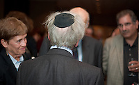 Nobel Peace Prize winner Elie Wiesel, (back to the camera),  chats with members of the audience at Congregation Torat El in Ocean where he was the guest speaker. This was at a reception there after he spoke.  // Russ DeSantis/For NJJN - 9/18/11