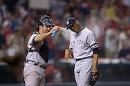 David Richard/MLB.com.New York closer Mariano Rivera, right, is greeted by catcher Jorge Posada with a can of bug spray in the bottom of the ninth inning ofGame 2 of the 2007 ALDS at Jacobs Field in Cleveland. The Yankees seemed bothered by a swarm of bugs that flew over the diamond.