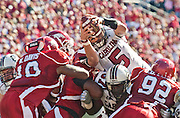 South Carolina quarterback Stephen Garcia (5) leaps into the end zone to score over Arkansas linebacker Wendel Davis, left, during the first half of an NCAA college football game in Fayetteville, Ark., Saturday, Nov. 7, 2009.