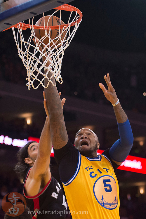 November 17, 2015; Oakland, CA, USA; Golden State Warriors center Marreese Speights (5) shoots the basketball against Toronto Raptors forward Luis Scola (4) during the fourth quarter at Oracle Arena. The Warriors defeated the Raptors 115-110.