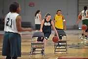 April 3, 2016; Indianapolis, Ind.; Jessica Madison dribbles between chairs during their practice session at Harvest Pavilion on the Indiana State Fair grounds.