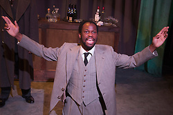 "© Licensed to London News Pictures. 15/01/2014. London, England. Stefan Adegbola as Othello. The Shakespearean tragedy ""Othello: The Moor of Venice"" opens at the Riverside Studios in Hammersmith, London in a ""Film Noir"" setting. Directed by Rebekah Fortune with Stefan Adegbola as Othello and Gillian Saker as Desdemona. Running form 15 January to 18 February 2014. Photo credit: Bettina Strenske/LNP"