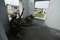 """03 APR 2012, LEHNIN/GERMANY:<br /> Scharfschuetzen """"Sniper"""" sichern das Vorruecken Ihrer Kammeraden, Kampfschwimmer der Bundeswehr trainieren """"an Land"""" infanteristische Kampf, hier Haeuserkampf- und Geiselbefreiungsszenarien auf einem Truppenuebungsplatz<br /> IMAGE: 20120403-01-044<br /> KEYWORDS: Marine, Bundesmarine, Soldat, Soldaten, Armee, Streitkraefte, Spezialkraefte, Spezialkräfte, Kommandoeinsatz, Übung, Uebung, Training, Spezialisierten Einsatzkraeften Marine, Waffentaucher"""