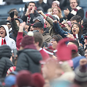 NEW HAVEN, CONNECTICUT - NOVEMBER 18:  Harvard supporters during the Yale V Harvard, Ivy League Football match at the Yale Bowl. Yale won the game 24-3 to win their first outright league title since 1980. The game was the 134th meeting between Harvard and Yale, a historic rivalry that dates back to 1875. New Haven, Connecticut. 18th November 2017. (Photo by Tim Clayton/Corbis via Getty Images)