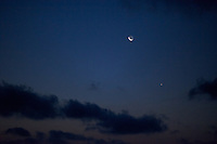 Pre-Dawn View of the Moon, Venus, and Mercury. Image taken with a Nikon D3x and 85 mm f/1.4G (ISO 1600, 85 mm, f/1.4, 1/30 sec). Raw image processed with Capture One Pro 6 and converted to jpg/sRGB with Photoshop CS5. Noise Reduction with NIK Define 2.0.