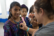 Volunteers and registered nurses working with the non-profit organization, Worthy Village, operate a community health clinic in the town of Santa Catarina in Guatemala. Many children and women were seen by the volunteers.