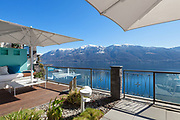 Terrace lounge with lake view in a luxury house