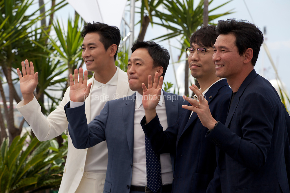 Actors Jung-min Hwang,  Sung-min Lee director Jong-bin Yoon, and actor Ji-Hoon Ju at the Gongjak (The Spy Gone North) film photo call at the 71st Cannes Film Festival, Friday 11th May 2018, Cannes, France. Photo credit: Doreen Kennedy
