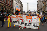 On US President Donald Trumps second day of a controversial three-day state visit to the UK, protesters refer to the import of chlorinated chicken and march down Whitehall to voice their opposition to the 45th American President and a future US/UK trade deal, down Whitehall, on 4th June 2019, in London England.
