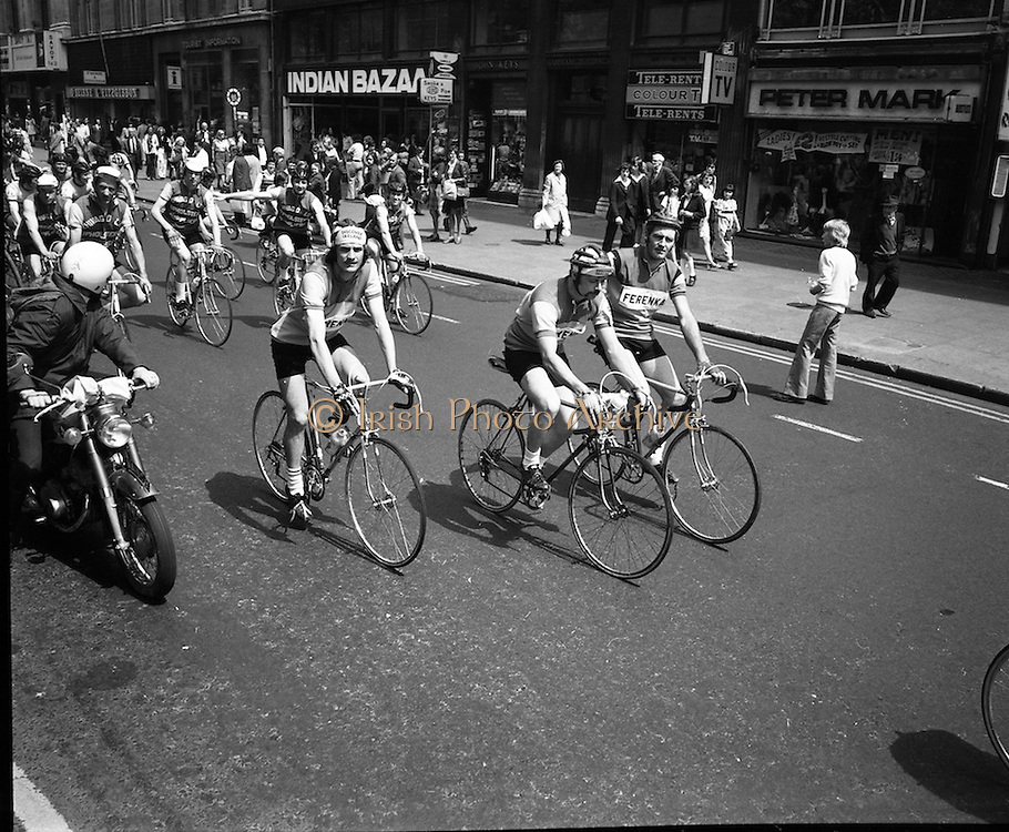 Start of Rás Tailteann. <br /> (J58).1975. 07.06.1975. 06.07.1975. 7th June 1975 saw the start of The Rás Tailteann cycle race. The race, which covers 900 miles around Ireland, will conclude in Limerick on Thursday 12th June. A field of seventy seven riders are listed to take part. The actress, Siobhan McKenna, graciously agreed to be the offical starter of the race.<br /> Picture of the cyclists parading through O'Connell Street, Dublin on their way to the start point at the GPO (General Post Office).