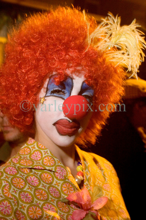 October 31, 2005. New Orleans, Louisiana. <br /> Halloween, post Katrina, New Orleans. As the city returns to a strange sense of normalcy and the citizens return, New Orleans once again hosts a Halloween parade and party. A woman dressed as a clown stands out in the crowd.<br /> Photo; ©Charlie Varley/varleypix.com