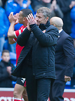 Football - 2013 / 2014 Premier League - Cardiff City vs. Chelsea<br /> <br />  Cardiff manager Ole Gunnar Solskjaer applauds the crowd at the end of the last game of the season & they are relegated to the championship at Cardiff City Stadium.<br /> <br /> COLORSPORT/WINSTON BYNORTH