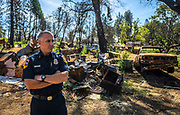 Paradise Fire Chief John Messina stands in the rubble of a burned down home on Sawmill Road in Paradise almost a year after the Camp Fire in Paradise on Oct. 15, 2019.
