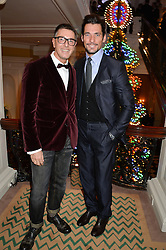 Left to right, STEFANO GABBANA and DAVID GANDY at the Claridge's Christmas Tree By Dolce & Gabbana Launch Party held at Claridge's, Brook Street, London on 26th November 2013.