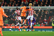 Sadio Mane of Liverpool (c) jumps for a header between Kurt Zouma (l) and Ryan Shawcross of Stoke City. Premier league match, Stoke City v Liverpool at the Bet365 Stadium in Stoke on Trent, Staffs on Wednesday 29th November 2017.<br /> pic by Chris Stading, Andrew Orchard sports photography.
