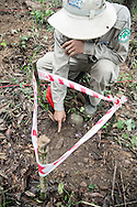 A bomb-disposal expert points to a UXO (Unexploded Ordnance), Quang Tri Province, Vietnam, Southeast Asia