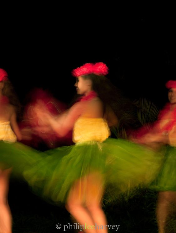 Dancers in grass skirts at Smith Family Garden Luau, Kaua'i, Hawai'i