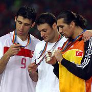Turkey's Hakan Sukur, Alpay Ozalan and Rustu Recber look at their third place medals