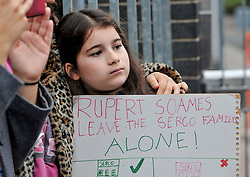 Pictured: Child protester carries placard condemning Riupert Soames, boss of private firm SERCO.<br /> <br /> Protesters gathered outside the main Home Office building in Glasgow to protest at private company SERCO's attempts to evict failed asylum seekers from their homes.<br /> <br /> © Dave Johnston / EEm