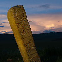 MONGOLIA. 2700+ year-old, bronze age Deer Stone at Ulaan Tolgai site near Lake Erkhel & Muren.  <br /> <br /> MS0702_060628_0487.NEF