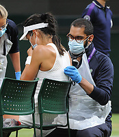 Lawn Tennis - 2021 All England Championships - Week Two - Monday - Wimbledon<br /> Emma Raducanu v Ajia Tomijanovic<br /> <br /> Emma Raducanu of GBR receives medical treatment on court in the 2nd set which resulted in her having to retire from the match<br /> <br /> Credit : COLORSPORT/Andrew Cowie