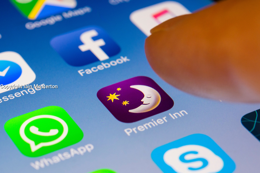 Premier Inn hotel chain booking app close up on iPhone smart phone screen
