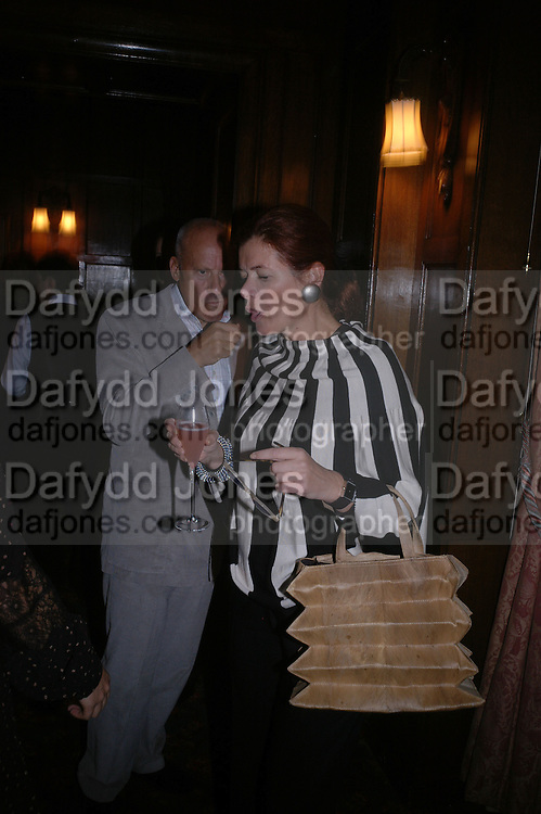 Lord and Lady Foster . Book launch for ' Picasso: Art Can Only Be Erotic' by diana Widmaier Picasso. American Bar at the Connaught. Carlos Place. London W1.  October 11 2005. ONE TIME USE ONLY - DO NOT ARCHIVE © Copyright Photograph by Dafydd Jones 66 Stockwell Park Rd. London SW9 0DA Tel 020 7733 0108 www.dafjones.com