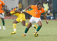 Photo: Steve Bond/Richard Lane Photography.<br /> Ivory Coast v Benin. Africa Cup of Nations. 25/01/2008. Didier Drogba (R) has his shirt tugged