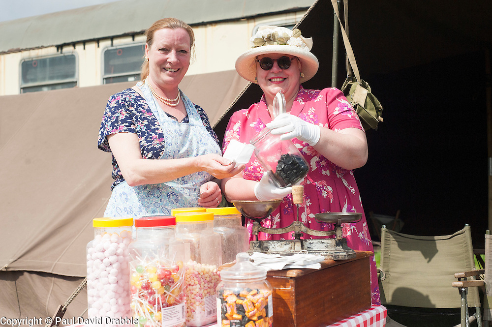 Northern World War II Association (NWW2A) members Christine Field and Nina Turton with their mobile vintage sweet shop. The two reenactors will be selling traditional sweets to raise funds for Cancer research UK during the 2013 season. Christine came up with the idea half way through last season and raised £230 for the Charity..5 May 2013.Image © Paul David Drabble