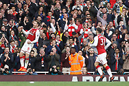 Aaron Ramsey of Arsenal (R) celebrates with his team mates after he scores his team's second goal. Premier league match, Arsenal v Swansea city at the Emirates Stadium in London on Saturday 28th October 2017.<br /> pic by Steffan Bowen, Andrew Orchard sports photography.