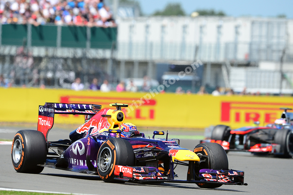 Mark Webber (Lotus-Renault) leads Jenson Button (McLaren-Mercedes) during the 2013 British Grand Prix in Silverstone. Photo: Grand Prix Photo