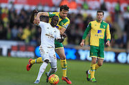 Modou Barrow of Swansea city is challenged by Russell Martin of Norwich city. Barclays Premier league match, Swansea city v Norwich city at the Liberty Stadium in Swansea, South Wales  on Saturday 5th March 2016.<br /> pic by  Andrew Orchard, Andrew Orchard sports photography.