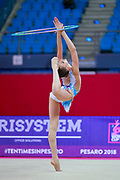 Crijanovschii Ella during qualifying hoop at the Pesaro World Cup April 13, 2018. She is a rhythmic gymnastics athlete from Moldova.