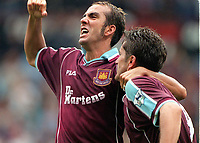 Paolo di Canio celebrates with Davor Suker after the 2nd West Ham goal. West Ham United v Manchester United, FA Premiership, 26/08/2000. Credit: Colorsport / Matthew Impey