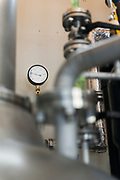 A pressure gauge on the still, Nekka Shochu Distillery, Tadami, Fukushima, Japan, February 20, 2018. The Nekka shochu distillery was founded in July 2016 and at that time was the smallest shochu distillery in Japan. It makes shochu from locally-grown rice, and is helping support a local economy that has languished since the nuclear disaster of 2011.