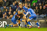 Duhan van der Merwe (#11) of Edinburgh Rugby is tackled by Richard Hibbard (#2) and Jordan Williams (#15) of Dragons Rugby during the Guinness Pro 14 2018_19 match between Edinburgh Rugby and Dragons Rugby at BT Murrayfield Stadium, Edinburgh, Scotland on 15 February 2019.