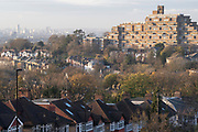 Suburban homes and flats with a cityscape looking north from Horniman Hill towards the prominent residential complex of Dawson Heights in East Dulwich, on 23rd November 2020, in London, England.
