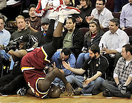 Cleveland Cavaliers' center Shaquille O'Neal goes head-over-heals into the media and fans during a game against the Washington Wizards at Quicken Loans Arena on Jan. 6, 2010 in Cleveland.