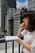Writer Polly Morland on the roof of the federal NYC Department of Buildings on Broadway, researching the chapter entitled 'The Skyline' for her book 'Risk Wise: Nine Everyday Adventures' by Polly Morland (Allianz, The School of Life, Profile Books, 2014).