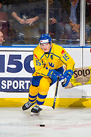 KELOWNA, BC - DECEMBER 18:  Oskar Bäck #15 of Team Sweden skates for the puck against Team Russia at Prospera Place on December 18, 2018 in Kelowna, Canada. (Photo by Marissa Baecker/Getty Images)***Local Caption***