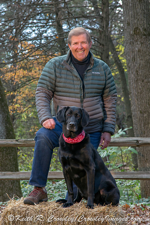 Ron Schara and his Celebrity Black Lab, Raven, pose for a portrait at Schara's home in Minnesota.