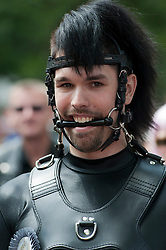 Man wearing leather costume at Christopher Street Day Parade in Berlin Germany 2011