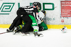 Referee pulling back when players fighting during Ice Hockey match between HK SZ Olimpija and EHC Alge Elastic Lustenau in Semifinal of Alps Hockey League 2018/19, on April 1, 2019, in Arena Tivoli, Ljubljana, Slovenia. Photo by Vid Ponikvar / Sportida