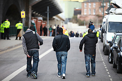 © Licensed to London News Pictures. 04/04/2013.Nottingham, UK. Nottingham residents who are sickened by the events in Derby walk toward Nottingham Crown Court before the vans leave to take the three guilt to start their sentences. The last day of the Philpott fire hearing. Three individuals, Mairead Philpott, Michael Philpott and Paul Mosley are sentenced for manslaughter of 6 children in Derby 2012 at Nottingham Crown Court. sentencing was postponed until 10:30am today (Thursday 4th April 2013)   .   Photo credit : Tom Maddick/LNP
