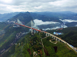 Teilst¸cke der hˆchsten Br¸cke der Welt werden zusammengef¸gt / 100916 *** <br /> BIJIE, CHINA - SEPTEMBER 10: <br /> Aerial view of the Beipan River expressway bridge (or Beipanjiang bridge) under construction on September 10, 2016 in Bijie, Guizhou Province of China. The 1,341.4-meter-long Beipan River expressway bridge has a height equivalent to a 200-story building, which makes it the world's highest bridge down to the ground or water surface. The bridge spanning the Beipanjiang Valley was started to build in 2013 and completed the main connection on September 10, 2016.