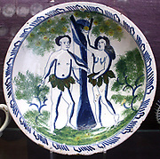 Dish: Adam and Eve Probably Bristol or Brislington, c1720-30.  This scene is thought to have been copied from a print by Pierre Lombart c1613-1682 who worked in London. The plate was fired face upwards and supported by pegs under the rim which projected out from the walls of the clay container in which the pieces were placed for firing.