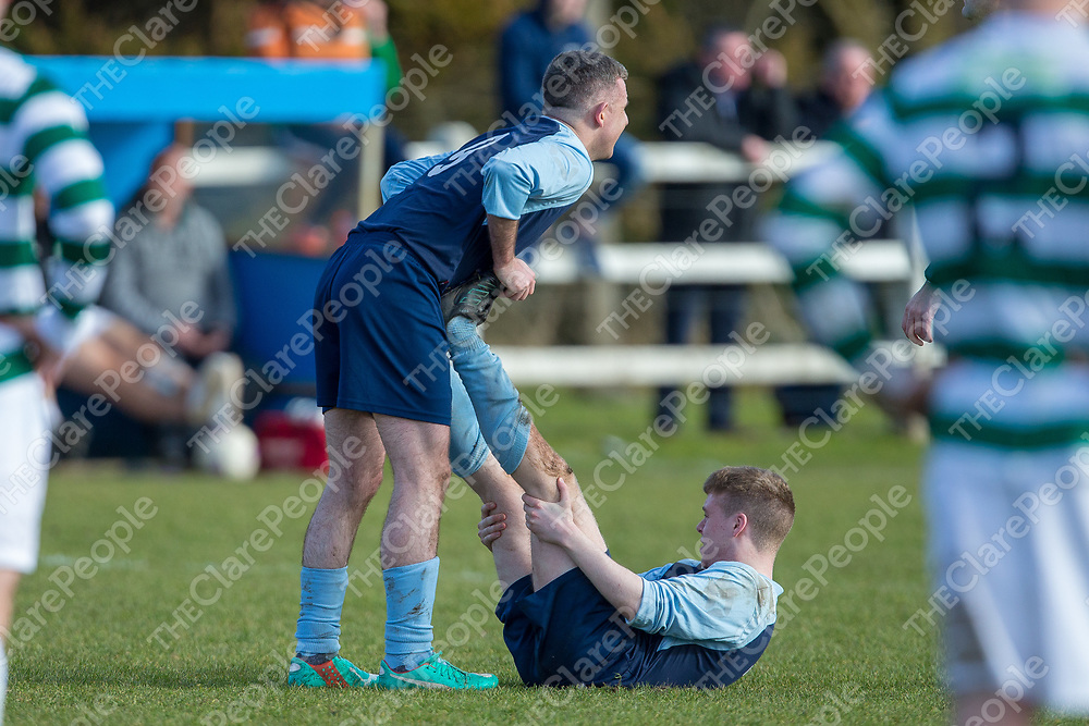 Shannon Town's Colin Scanlon helps team mate Brian O'Connor with cramp as both teams head into extra time
