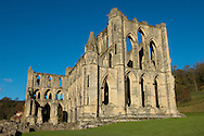 Rievaulx Abbey main church.North Yorkshire, England . Rievaulx Abbey was a Cistercian abbey in Rievaulx, situated near Helmsley in the North York Moors National Park, North Yorkshire, England. Rievaulx Abbey was one of the great abbeys in England until it was seized under Henry VIII of England in 1538 during the dissolution of the monasteries. Founded in 1132 by twelve monks from Clairvaux Abbey. Rievaulx Abbey remote location was well suited to the order's ideal of a strict life of prayer and self-sufficiency with little contact with the outside world. <br /> <br /> Visit our MEDIEVAL PHOTO COLLECTIONS for more   photos  to download or buy as prints https://funkystock.photoshelter.com/gallery-collection/Medieval-Middle-Ages-Historic-Places-Arcaeological-Sites-Pictures-Images-of/C0000B5ZA54_WD0s