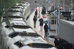 ©Licensed to London News Pictures 14/10/2019.<br /> Pettswood,UK A wet weather morning for these London commuters at Pettswood railway station in Pettswood, South East London. Forecasters say more than two inches of rain could fall within 12 hrs today. Photo credit: Grant Falvey/LNP